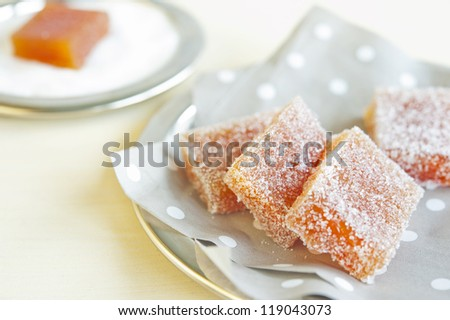 Pieces of fruit candy on a napkin in peas on a wooden table