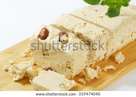 Pieces of Greek halva with almonds