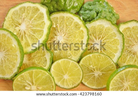 Pieces of lemon and bergamot close up - stock photo