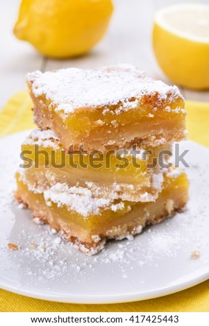Pieces of lemon pie on white plate
