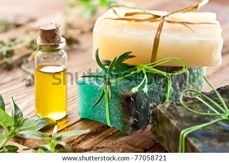 Pieces of natural soap with herbs and oil.