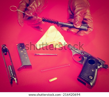 Pieces of Non Assembled Pistol on Red Background, Instagram Effect  - stock photo