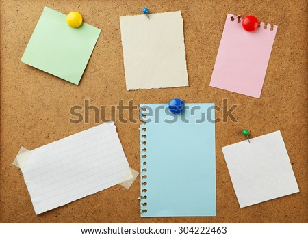Pieces of note paper on brown background