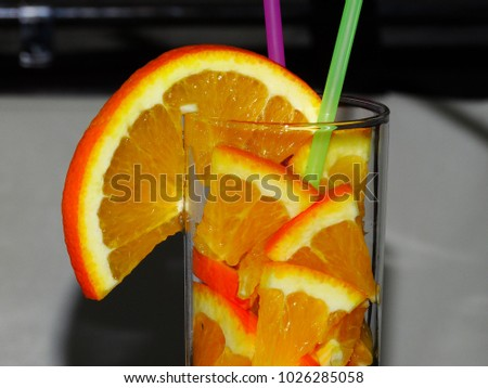 pieces of orange in a glass