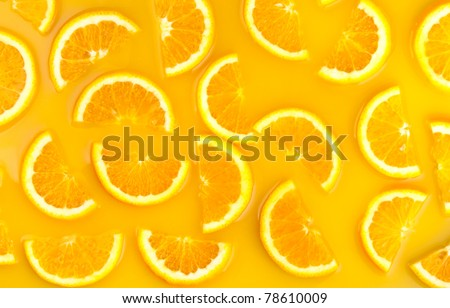 pieces of orange in orange juice - stock photo