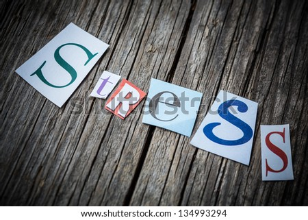pieces of paper that say 'stress' - stock photo