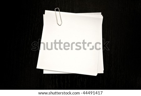 Pieces of paper with clip isolated on a black background - stock photo