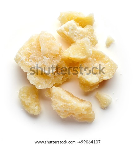 Pieces of parmesan cheese isolated on white background, top view