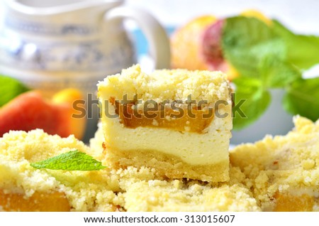 Pieces of peach pie with curd on a light background.