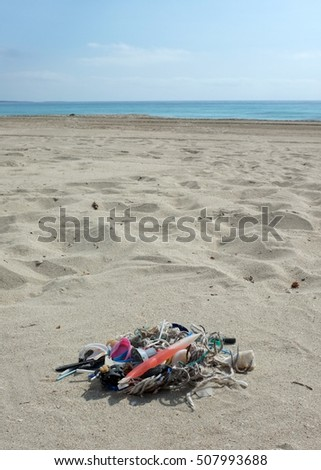 Pieces of plastic on the beach