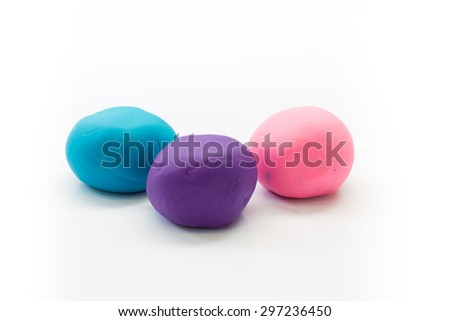 pieces of plasticine on white background - stock photo