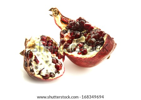 Pieces of pomegranate on a white background
