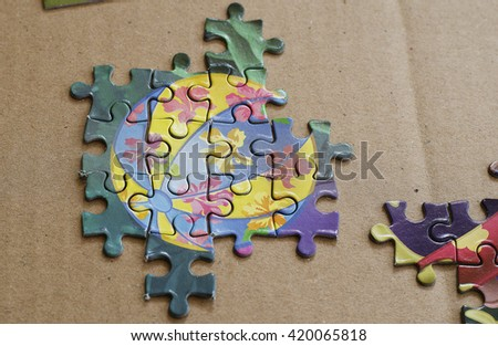 Pieces of puzzle, test skill put on paper background. - stock photo
