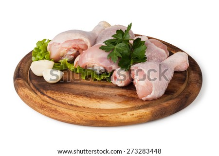 Pieces of raw chicken meat on a white background
