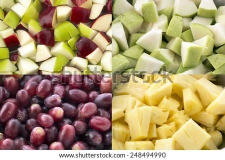 Pieces of red and green apples,Sliced pineapple,grape and Sliced guava prepare for making fruit salad - stock photo