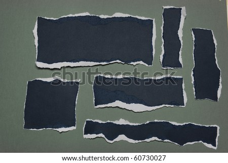 Pieces of Rip Paper with white edges isolated on a green background - stock photo