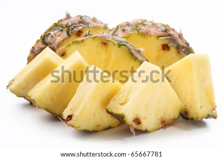 Pieces of ripe pineapple. Isolated on a white. - stock photo