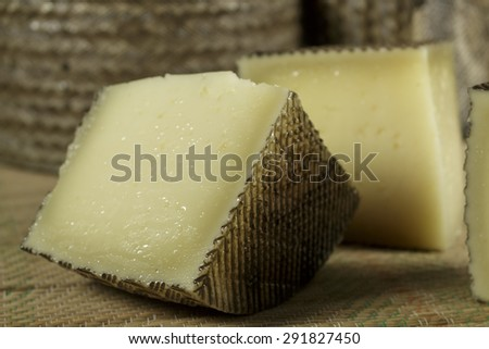 Pieces of sheep milk cheese - stock photo