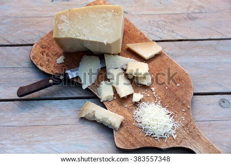 pieces of sliced cheese on a cutting board