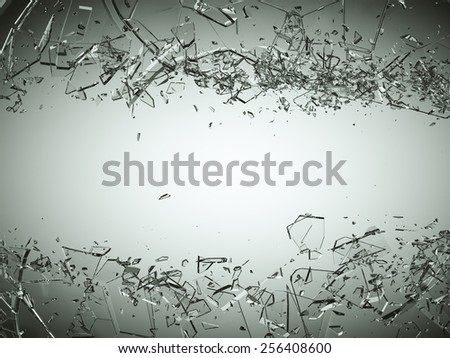 Pieces of splitted or cracked glass on grey gradient background. Large resolution - stock photo