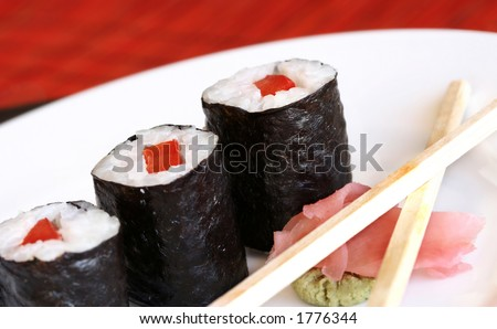 pieces of sushi on a white plate.  Shallow D.O.F - stock photo