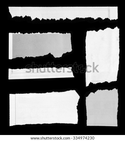 Pieces of torn paper on black - stock photo