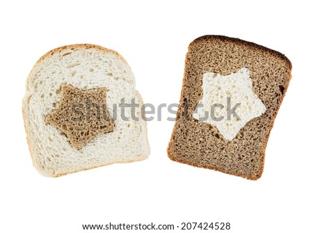 Pieces of white and brown bread with silhouette of star isolated over white