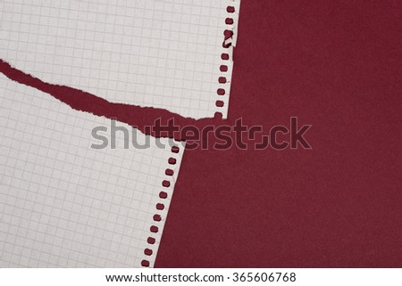 Pieces of white torn paper over the dark red background - stock photo