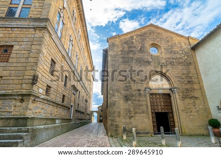 PIENZA, ITALY - January 25, 2015: street view of historic centre and cathedral in Pienza, Italy. In 1996 the town of Pienza was added to the UNESCO list of World Heritage Sites.