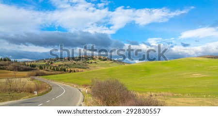 PIENZA, ITALY - January 25, 2015: street view of tuscan landscape and Pienza skyline near Pienza, Italy.  In 2004 the Val dOrcia was added to the UNESCO list of World Heritage Sites.