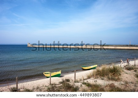 Pier and beach with boats in Hel, resort town on Hel Peninsula at Baltic Sea and Puck Bay in Poland