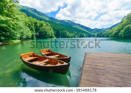Pier and boats in Lake Biograd (Biogradsko jezero), Biogradska Gora national park, Montenegro - stock photo