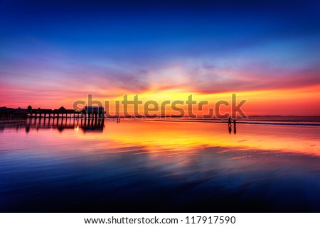 Pier at Old Orchard Beach, Maine, in vivid light before sunrise