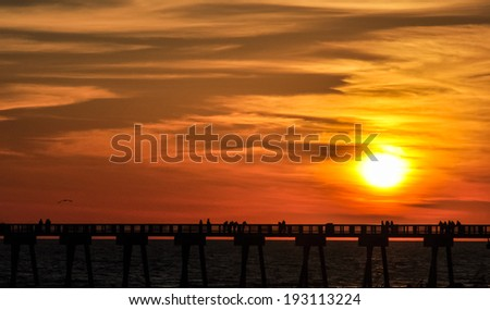 pier at sunset - stock photo