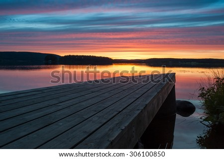 Pier at sunset - stock photo