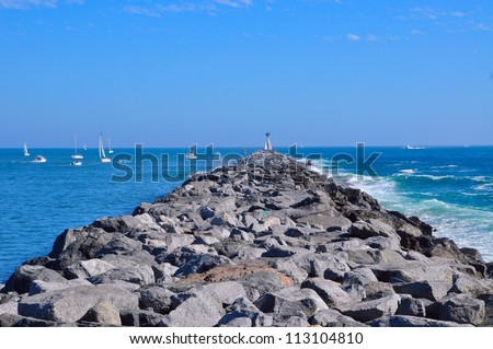 Pier/Breakwater at Balboa beach - stock photo