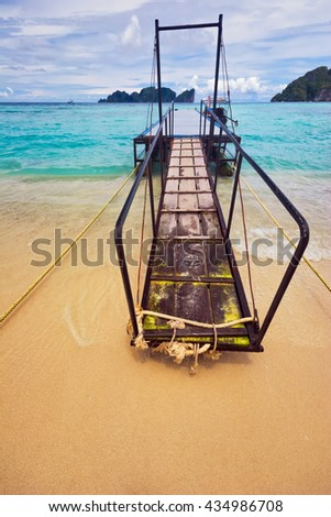pier for boats on a tropical beach. Phi Phi. Thailand