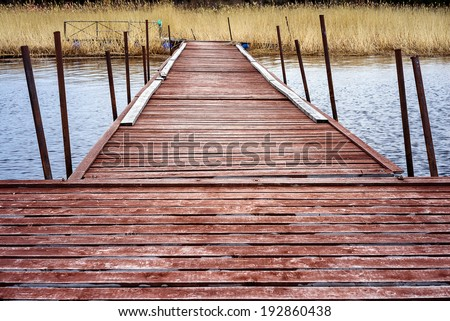 Pier for pleasure and fishing boats on shore of Lake Ladoga in Karelia
