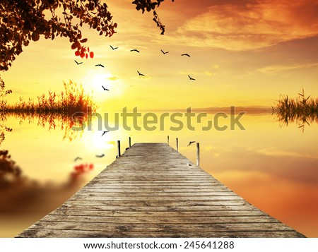 pier in a corner of the lake - stock photo