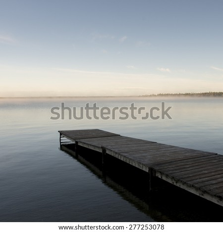 Pier in a lake, Riding Mountain National Park, Manitoba, Canada - stock photo