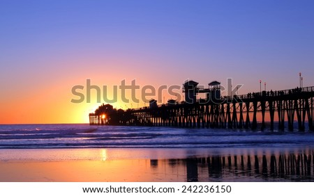 Pier in California at sunset  - stock photo