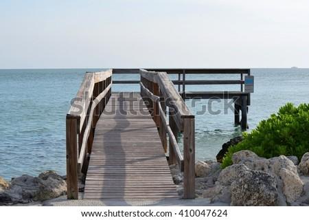 Pier in sunset park - stock photo