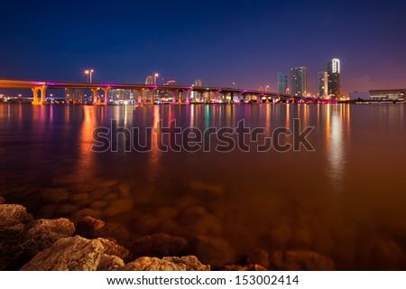 Pier in the Atlantic ocean with cityscape in the background, Miami, Miami-Dade County, Florida, USA - stock photo