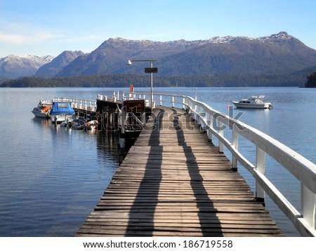 Pier lake mountain view Patagonia Argentina. - stock photo