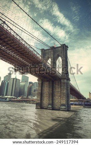 Pier of Brooklyn Bridge in New York CIty, retro style, Manhattan, New York, USA - stock photo