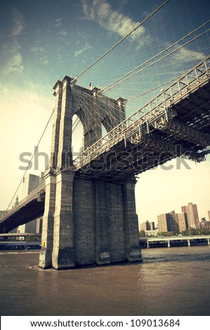 Pier of Brooklyn Bridge in New York CIty, vintage style, Manhattan, New York, USA - stock photo