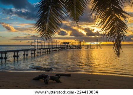 Pier on a tropical island  - stock photo