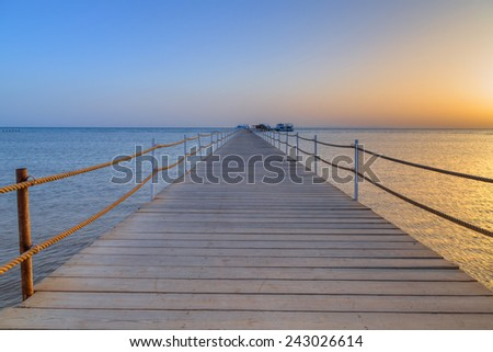 Pier on red sea at sunset, Hurghada in Egypt - stock photo