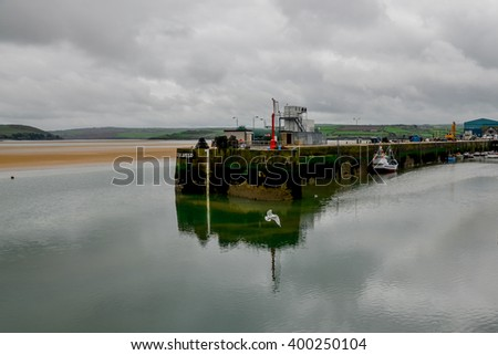 pier on river Camel at low tide Padstow, Cornwall, England, United Kingdom - stock photo