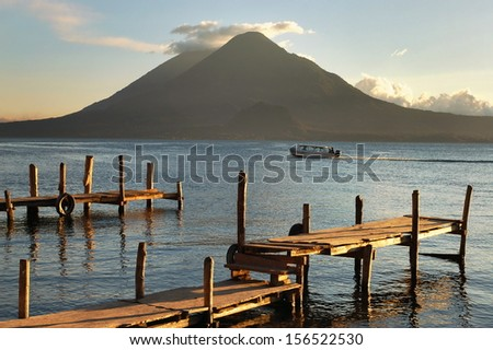 Pier on the Atitlan Lake in Guatemala at Sunset - stock photo